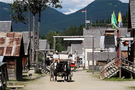 settlement - Man posing as a Prospector driving horse-drawn wagon through Barkerville Historic Town in British Columbia, Canada Stock Photo - Rights-Managed, Code: 700-08657522