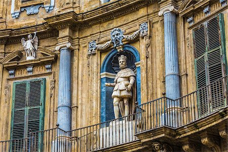 Statue of Philip IV on the North building at Piazza Vigliena (Quattro Canti) on Corso Vittorio Emanuele in the historic center of Palermo in Sicily, Italy Stock Photo - Rights-Managed, Code: 700-08701895