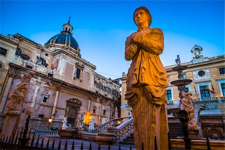 Close-up of statue illuminated at dusk at the Pretoria Fountain in Piazza Pretoria (Pretoria Square) in the historic center of Palermo in Sicily, Italy Stock Photo - Rights-Managed, Code: 700-08701911
