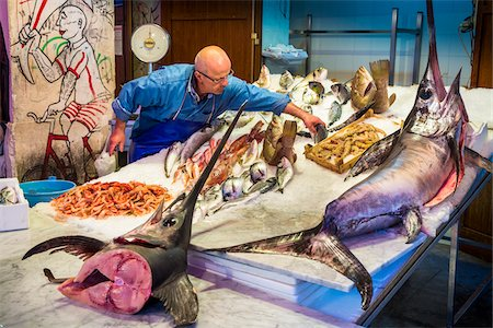 displaying - Fishmonger placing fish on ice in display at Vucciria Market in Palermo, Sicily, Italy Stock Photo - Rights-Managed, Code: 700-08701913
