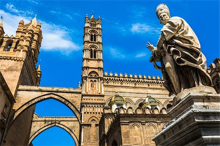 Statue of Archbishop and arcades connecting main building to the palace at the Palermo Cathedral in historic Palermo in Sicily, Italy Stock Photo - Rights-Managed, Code: 700-08701923