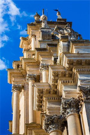 Low angle view of the ornate mouldings and pillars of the Cathedral of Saint George (Duomo di San Giorgio) against a blue sky in Ragusa in Sicily, Italy Stock Photo - Rights-Managed, Code: 700-08723102