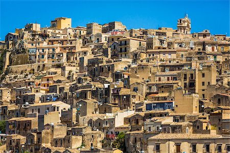 european hillside town - Rooftops of homes made of stone compacted on mountain side against a blue sky in historical Modica in the Province of Ragusa in Sicily, Italy Stock Photo - Rights-Managed, Code: 700-08723120