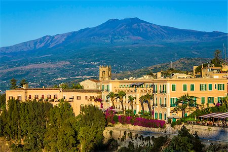 european hillside town - View of Taormina with Mount Etna in the background, Sicily, Italy Stock Photo - Rights-Managed, Code: 700-08723303
