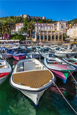 european hillside town - Boats docked at marina with the Venetian Loggia and the Hvar Fortress overlooking the harbour at the Old Town of Hvar on Hvar Island, Croatia Stock Photo - Rights-Managed, Code: 700-08765411