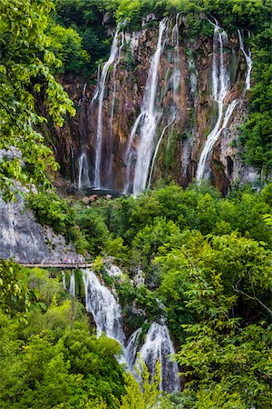 People on a footbridge crossing the large waterfall at Plitvice Lakes National Park in Lika-Senj county in Croatia Stock Photo - Rights-Managed, Code: 700-08765475