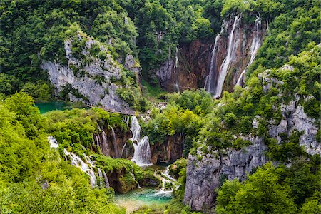 The tranquil, large waterfall at Plitvice Lakes National Park in Lika-Senj county in Croatia Stock Photo - Rights-Managed, Code: 700-08765470