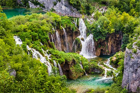 The large waterfall and lush vegetation at Plitvice Lakes National Park in Lika-Senj county in Croatia Stock Photo - Rights-Managed, Code: 700-08765471