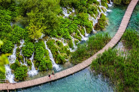 Footbridge crossing the turquoise lake water and waterfalls at the Plitvice Lakes National Park, Croatia Stock Photo - Rights-Managed, Code: 700-08765484