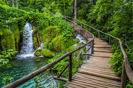 Wooden footbridge crossing over the waterfalls at the Plitvice Lakes National Park, Croatia Stock Photo - Rights-Managed, Code: 700-08765486