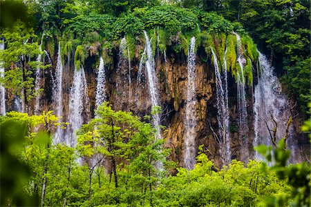 Waterfalls and lush vegetation at the Plitvice Lakes National Park, Croatia Stock Photo - Rights-Managed, Code: 700-08765487