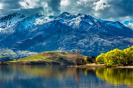 Shoreline of lake and mountain range at Glendhu Bay in the Otago Region of New Zealand Stock Photo - Rights-Managed, Code: 700-08765549