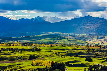 Rain clouds over the mountains and the Wakatipu Basin near Queenstown in the Otago Region of New Zealand Stock Photo - Rights-Managed, Code: 700-08765554
