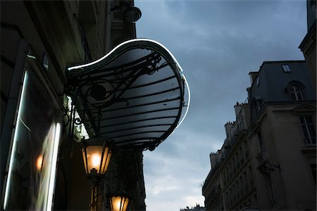 scroll (design) - Front entrance to a typical Parisian theater with its canopy, before the rain, France Stock Photo - Rights-Managed, Code: 700-08765572