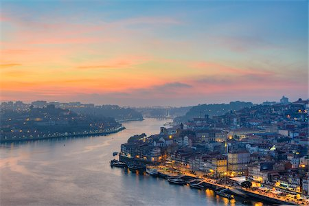 Overview of the Douro River with Riberia illuminated at sunset in Porto, Portugal Stock Photo - Rights-Managed, Code: 700-08865253