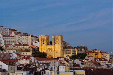 portuguese (places and things) - Overview of the rooftops of the historical buildings of the Alfama District at sunset with the sunlit Lisbon Cathedral (Se Cathedral) in Lisbon, Portugal Stock Photo - Rights-Managed, Code: 700-08865284