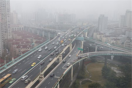 Elevated roadways meet in the mist, Changning Qu, Shanghai, China Stock Photo - Rights-Managed, Code: 700-08865316
