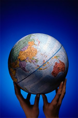 Hands Holding Globe Pacific Rim Stock Photo - Rights-Managed, Code: 700-00008694