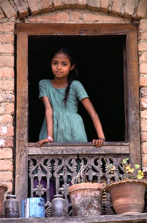 Girl Standing at Window Nepal Stock Photo - Rights-Managed, Code: 700-00002192