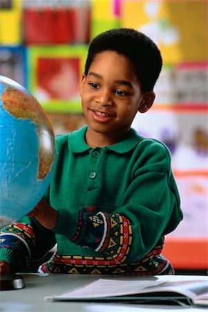 Boy in Classroom Looking at Globe Stock Photo - Rights-Managed, Code: 700-00017228