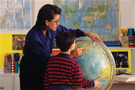 Female Teacher and Student in Classroom Looking at Globe Stock Photo - Rights-Managed, Code: 700-00017346