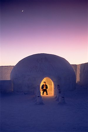 Man in Igloo at Dusk Jukkasjarvi North of Arctic Circle, Lapland, Sweden Stock Photo - Rights-Managed, Code: 700-00025967