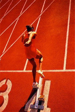 Female Runner at Starting Line Stock Photo - Rights-Managed, Code: 700-00026472