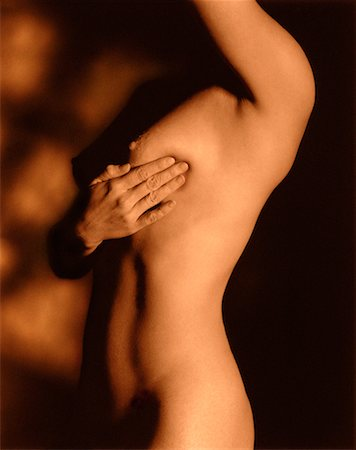 Nude Woman Performing Breast Exam Stock Photo - Rights-Managed, Code: 700-00027348