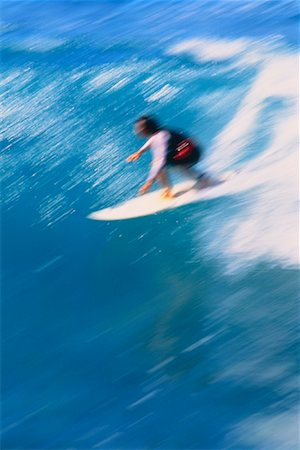 Blurred View of Man Surfing Hawaii, USA Stock Photo - Rights-Managed, Code: 700-00028702
