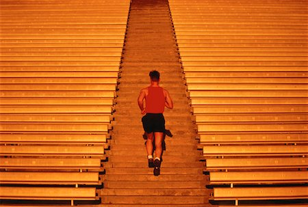 peter griffith - Back View of Man Running Up Stadium Steps Stock Photo - Rights-Managed, Code: 700-00029181