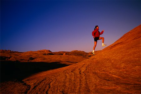 peter griffith - Woman Running Up Hill Stock Photo - Rights-Managed, Code: 700-00029489