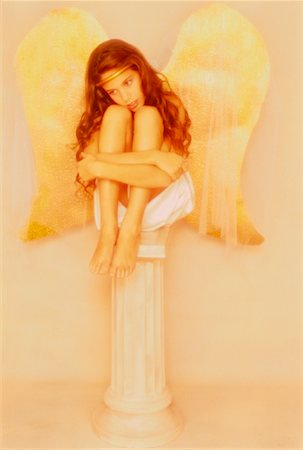 preteen girl feet - Girl Sitting on Pedestal Dressed as Angel Stock Photo - Rights-Managed, Code: 700-00021560