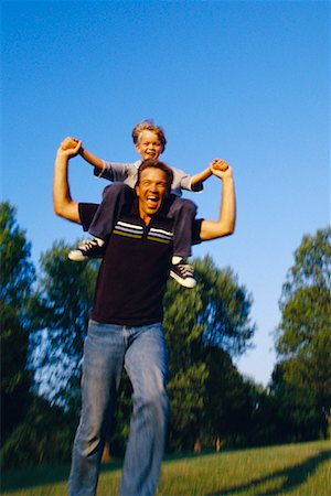 peter griffith - Father Carrying Son on Shoulders Outdoors Stock Photo - Rights-Managed, Code: 700-00038390
