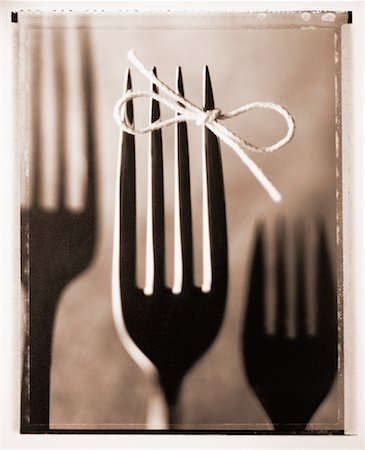 Fork with String Tied Around Tine Stock Photo - Rights-Managed, Code: 700-00030166
