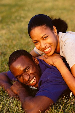 peter griffith - Portrait of Couple Lying in Field Smiling Stock Photo - Rights-Managed, Code: 700-00031599