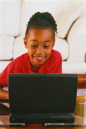 peter griffith - Girl Using Laptop Computer Stock Photo - Rights-Managed, Code: 700-00032607