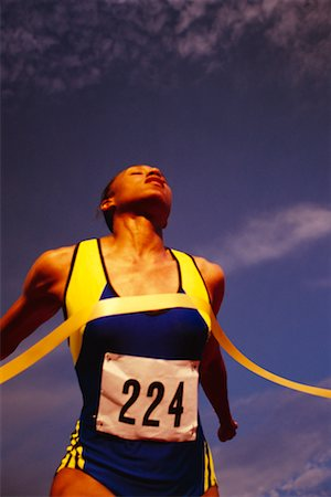 peter griffith - Woman Crossing Finish Line Stock Photo - Rights-Managed, Code: 700-00033315