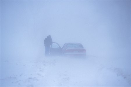Man Standing Outside of Car in Snowstorm Southern Ontario, Canada Stock Photo - Rights-Managed, Code: 700-00033521