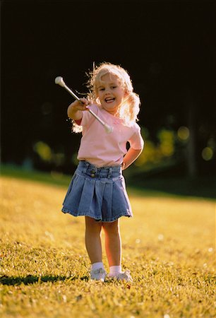 Girl Twirling Baton Outdoors Stock Photo - Rights-Managed, Code: 700-00044777