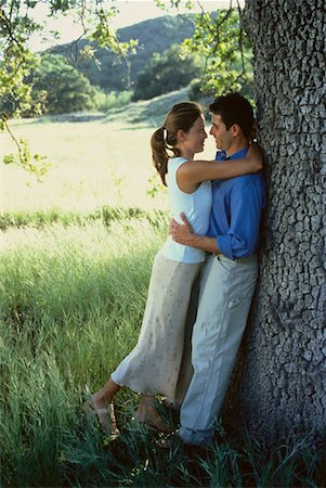 peter griffith - Couple Embracing near Tree Stock Photo - Rights-Managed, Code: 700-00046637