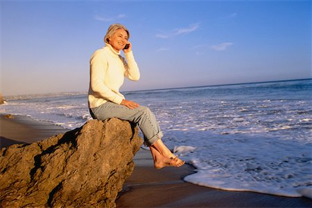 peter griffith - Mature Woman Using Cell Phone on Beach Stock Photo - Rights-Managed, Code: 700-00046996