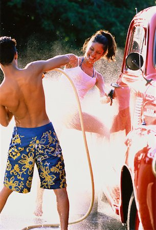 Teenage Couple in Water Fight Stock Photo - Rights-Managed, Code: 700-00047019