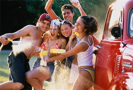 Group of Teenagers in Water Fight While Washing Truck Stock Photo - Rights-Managed, Code: 700-00047020