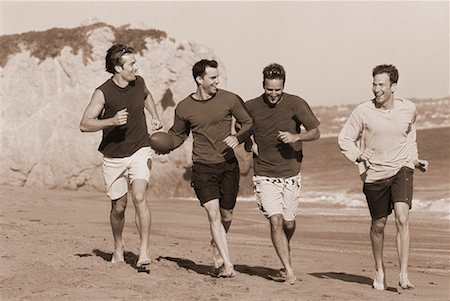 peter griffith - Group of Men Running on Beach With Football Stock Photo - Rights-Managed, Code: 700-00047241
