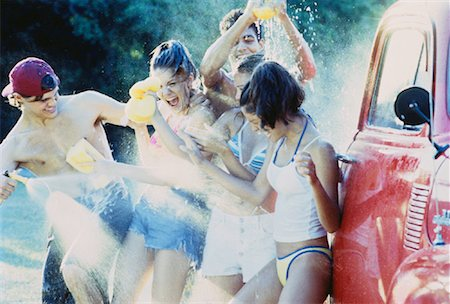 Group of Teenagers Having Water Fight while Washing Truck Stock Photo - Rights-Managed, Code: 700-00047324