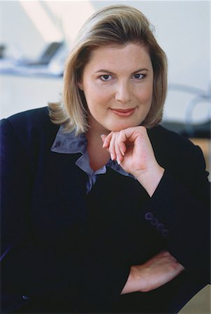 Portrait of Businesswoman Resting Head on Hand Stock Photo - Rights-Managed, Code: 700-00049626