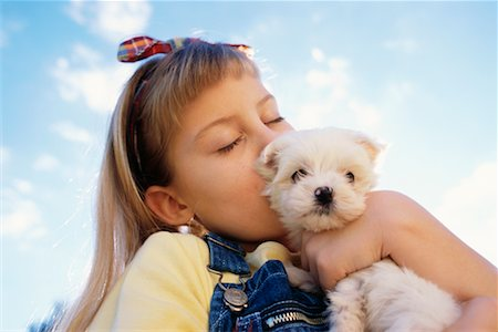 dog kissing girl - Girl Kissing Puppy Outdoors Stock Photo - Rights-Managed, Code: 700-00041486