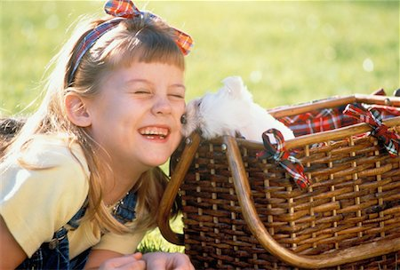 dog kissing girl - Girl with Puppy in Picnic Basket Stock Photo - Rights-Managed, Code: 700-00041487