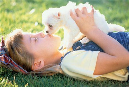 dog kissing girl - Girl Kissing Puppy Outdoors Stock Photo - Rights-Managed, Code: 700-00041532