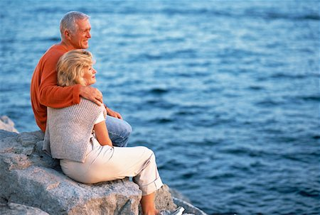 peter griffith - Mature Couple Sitting on Rocks Near Water Stock Photo - Rights-Managed, Code: 700-00054002